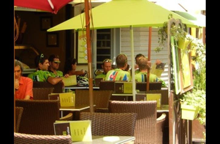Lunch time for a team from the Tour de France at the creperie outside the apartment